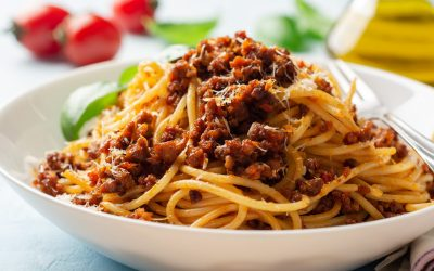 Spaghetti pasta bolognese in plate on concrete background