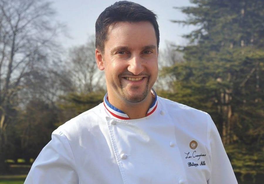 Philippe Mille in divisa da chef all'aperto